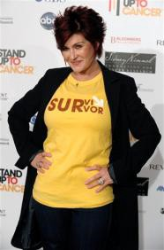 Sharon Osbourne To Give Breast Implants To Ozzy