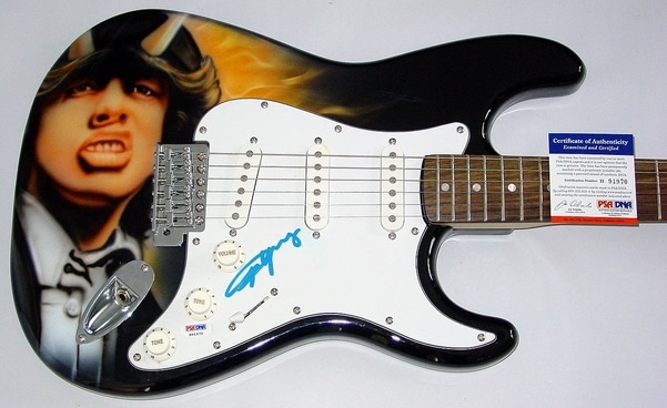 Angus Young Autographed Guitar Being Sold For Charity