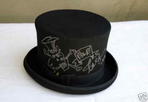 Slash Auctioning Top Hat, Book And Photo For Charity